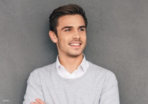 Young man in Grey Sweater